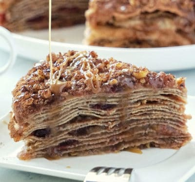 Healthy Apple Crepe Cake – a gluten free, dairy free and refined sugar free dessert with a sweet-spicy flavor of cinnamon and naturally sweetened with honey. This apple crepe cake recipe consists of 15 layers of thin gluten free and dairy free crepes separated with flavorful cooked apples that can be served with a drizzle of dairy free caramel. Recipe for caramel sauce included!