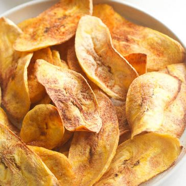 Learn how to make healthy oven baked plantain chips at home - paleo, vegan, gluten free, clean eating and whole 30 compliant. These baked plantain chips are an easy, healthy snack or side dish. You can use avocado oil or coconut oil, make them sweet or savory. These are my favorite healthy snack for satisfying my salty/crunchy cravings!