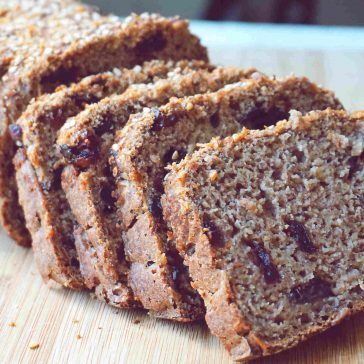 Vegan Gluten Free Banana Bread made with healthy clean ingredients (no eggs, no dairy). This sourdough banana bread recipe is also sugar free, oil free and nut free. Super moist, fluffy and it keeps its shape when slicing, perfect for a vegan gluten free breakfast.