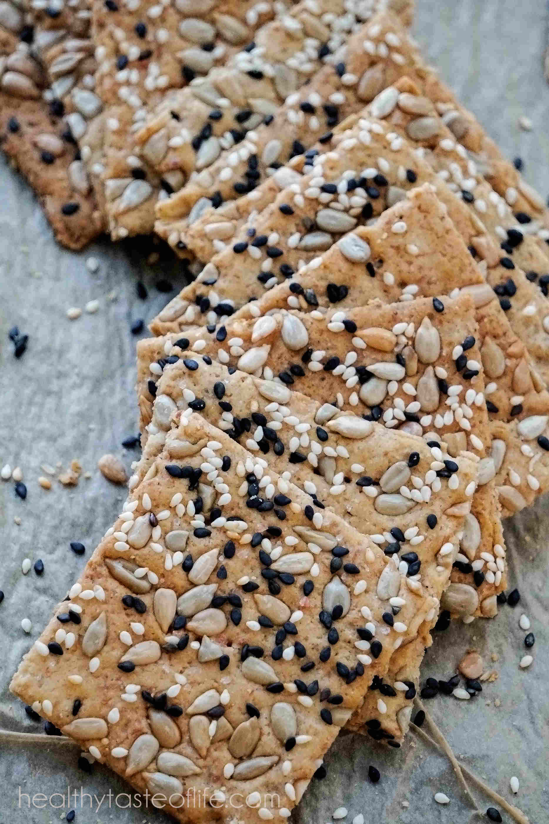 This homemade gluten free crackers recipe uses a mix of gluten free flours including rice flour and a variety of seeds.