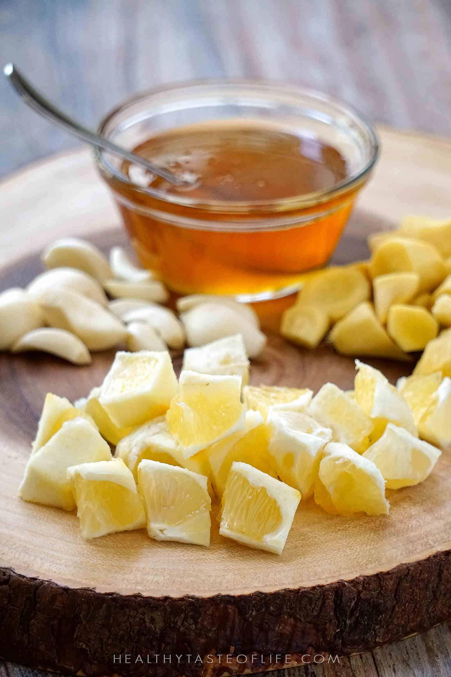 Immune boosting tonic recipe made with simple healing ingredients, honey, lemon, ginger, garlic