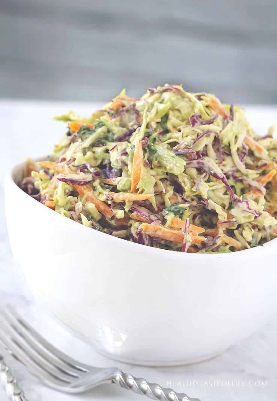 Vegan keto paleo whole30 coleslaw recipe and creamy avocado dressing without mayo.