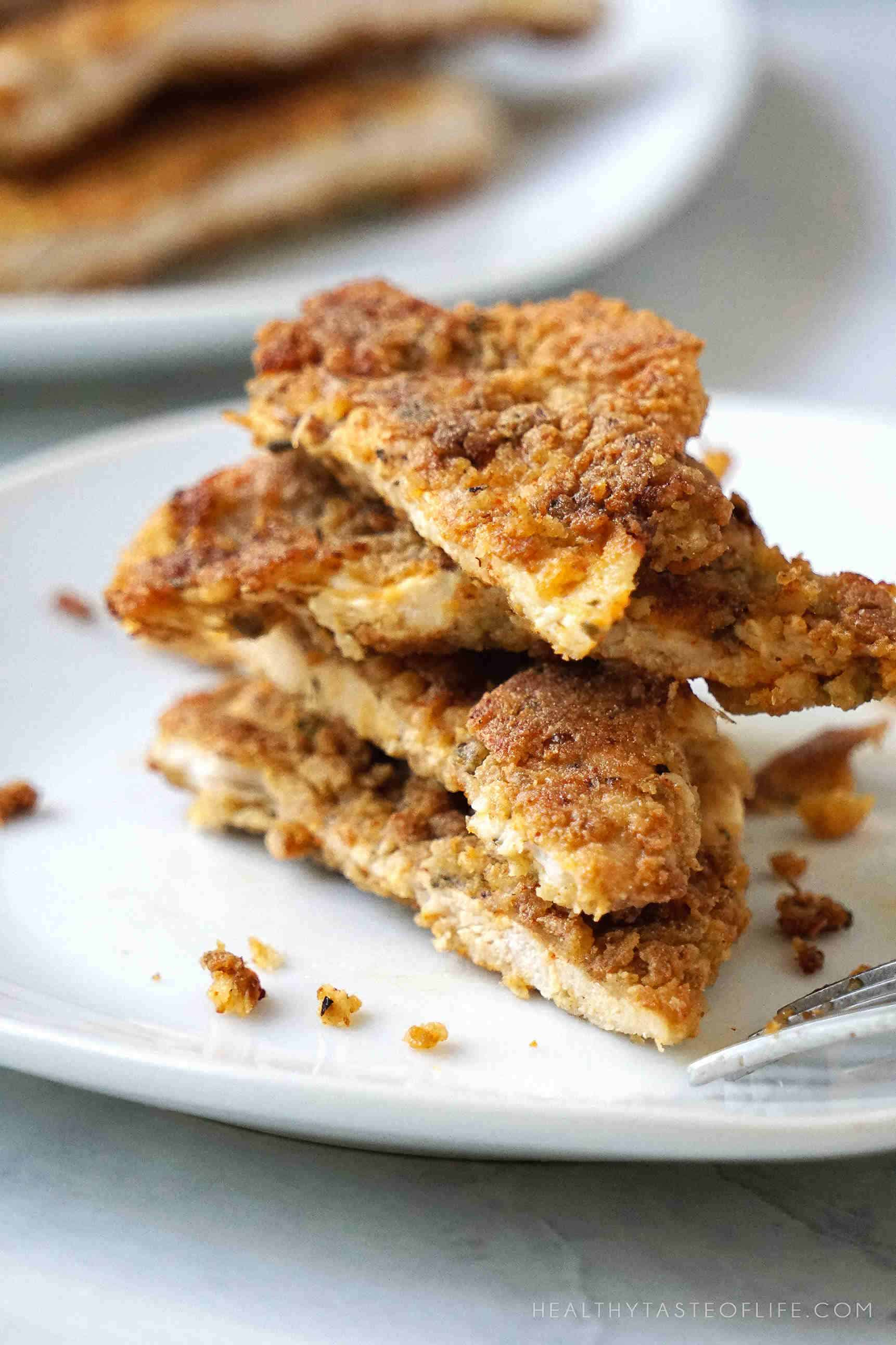 Gluten Free Chicken cutlets without eggs coated in a mustard mixture and pan fried for a golden tasty crust. A quick and easy gluten free, dairy free and egg free recipe to add to your chicken dinner collection!