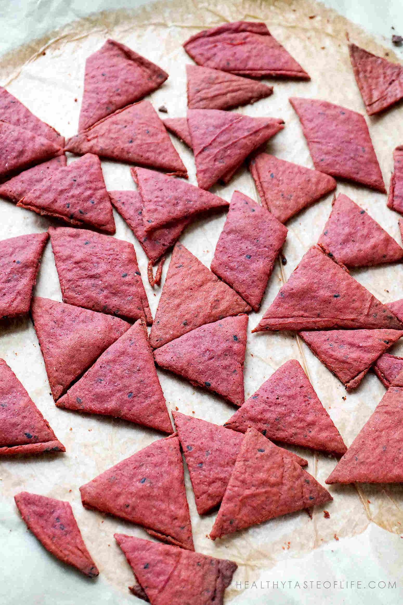 beet crackers cut into triangular pieces
