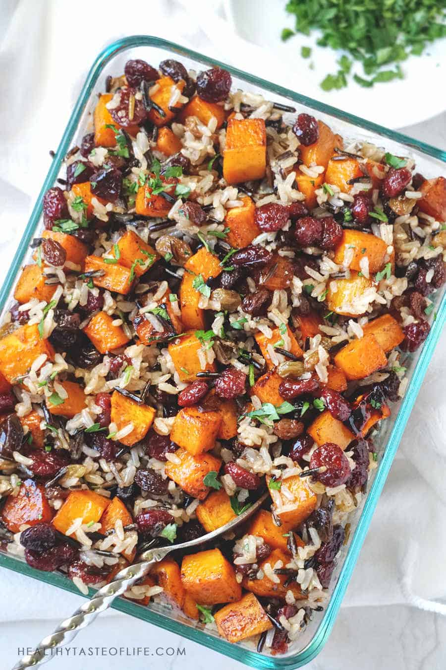 One of my favorite baked butternut squash recipes: it's easy and simple to make, perfect as a meatless dinner or side dish recipe : great for Thanksgiving or Christmas. This butternut squash casserole provides a nice alternative to plain rice side dishes. It's healthy, sweet due to roasted butternut squash (cubed and caramelized), dried fruit and a sweet balsamic sauce. #butternutsquashrecipe  #roastedbutternutsquash #vegan #healthy #recipes #baked