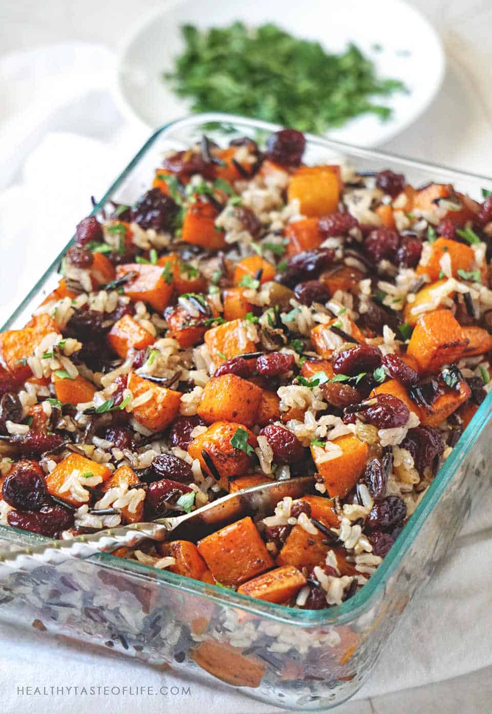 Vegan Butternut Squash Casserole with sweet potatoes and rice finished with a sweet balsamic sauce, perfect as a side dish or meal. This vegan butternut squash casserole is easy to make, full of flavor and it's naturally gluten free and dairy free! #butternutsquash #casserole  #vegan  #glutenfree  #sidedish #thanksgiving  #sweetpotatoes