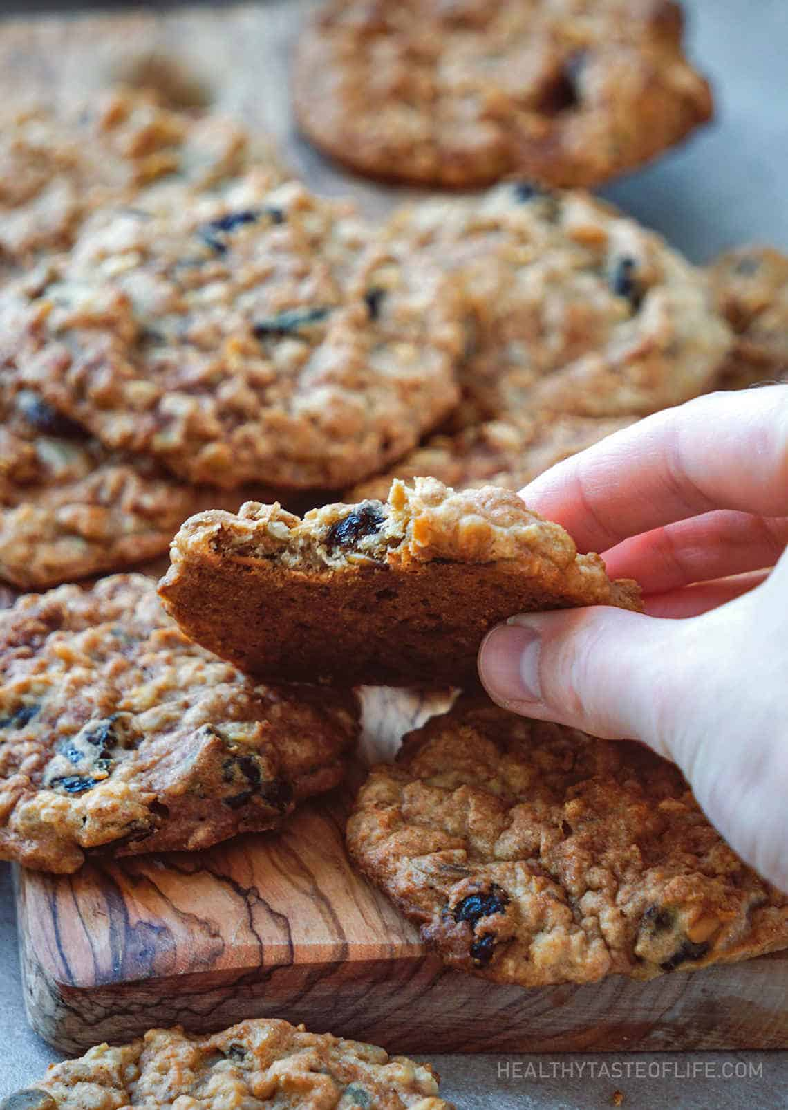 Healthy oatmeal cookies (vegan gluten free with applesauce) seeds, dried fruit held in a hand.