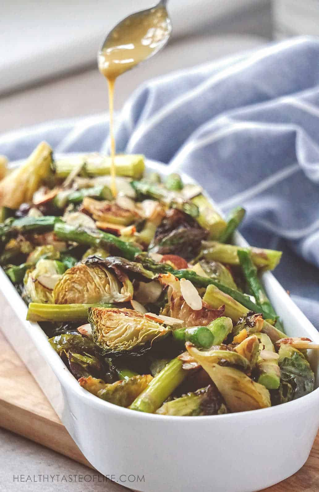 Keto Brussels Sprouts Recipe + Video. Oven roasted keto Brussels Sprouts and asparagus – easy , low carb recipe that yields brown crispy Brussels sprouts and just the right tenderness without using a ton of herbs, spices or mask their flavor with bacon. A light flavorful keto and low carb side dish without dairy! #keto #lowcarb #brusselssprouts #dairyfree
