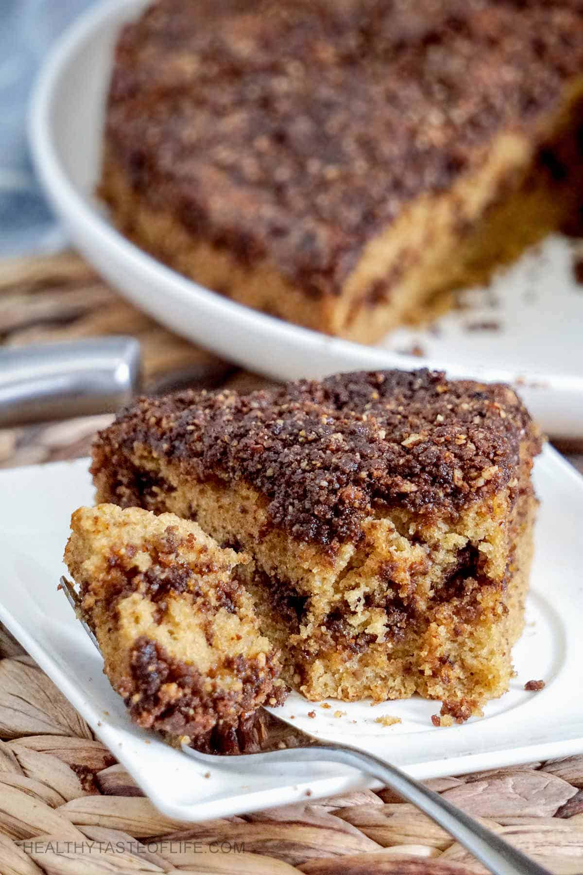 Dairy free gluten free coffee cake with cinnamon, walnut coffee crumb. A gluten free coffee cake recipe that you will enjoy again and again. Its easy, moist, fluffy and stays like this for days! #glutenfreecoffeecake #dairyfree #glutenfree #refinedsugarfree #coffeecake