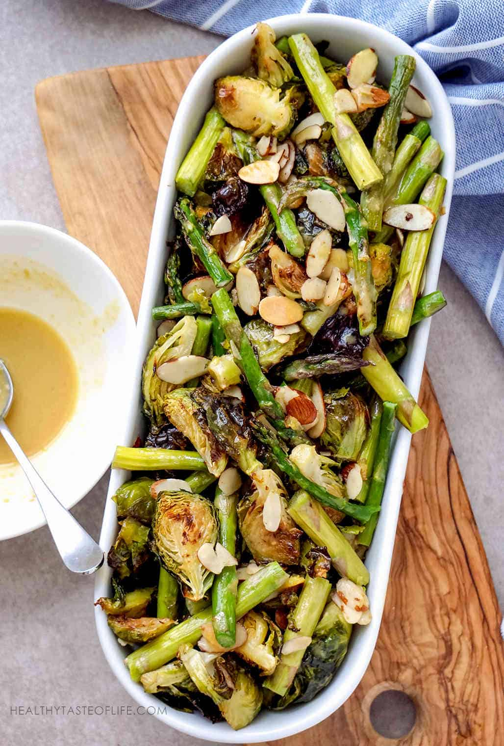 Oven Roasted Brussels Sprouts Asparagus Almonds with a lemon maple mustard sauce  (Vegan Recipe)