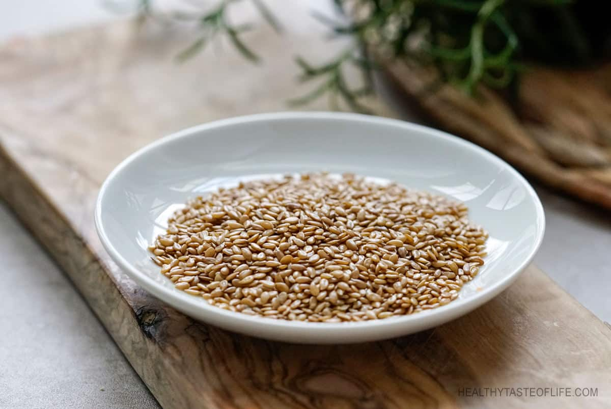 Golden whole flax seeds on a plate