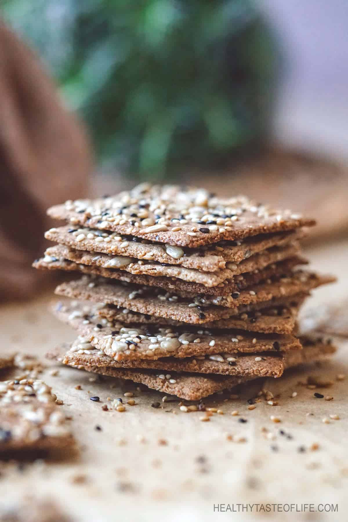 Keto seed crackers recipe (dairy free vegan) that is suitable for keto, paleo and vegan eaters. Use  these keto seed crackers as a low carb snack, or served along with your salad or soup.  #ketocrackers #lowcrabcrackers