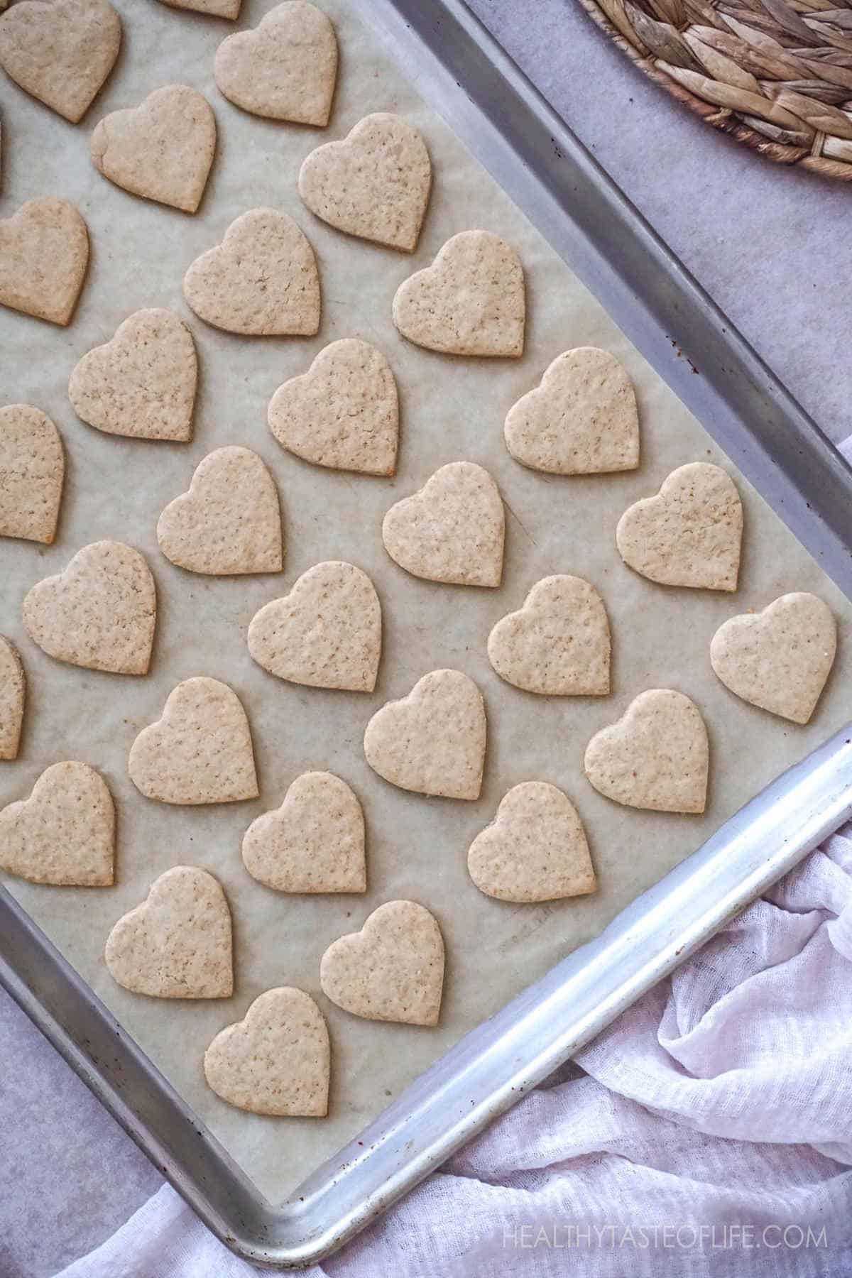Healthy Vegan Gluten Free Heart Shaped Cookies on  a baking sheet