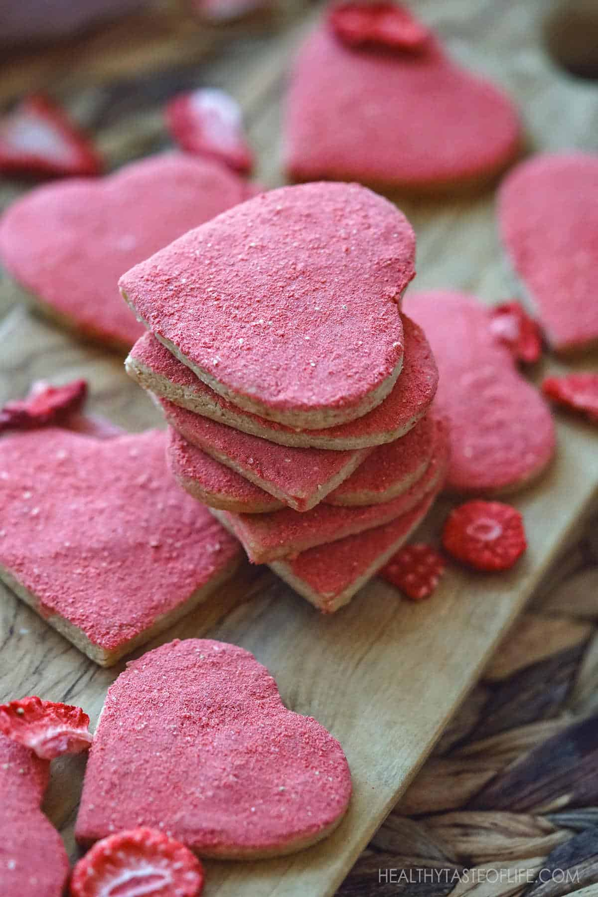 Heart shaped vegan gluten free cut out sugar cookies flavored with freeze dried strawberries : with a nice crisp around the edges and hints of buttery shortbread notes - gluten free valentine sugar cookies - vegan valentine sugar cookies - vegan heart shaped cookies