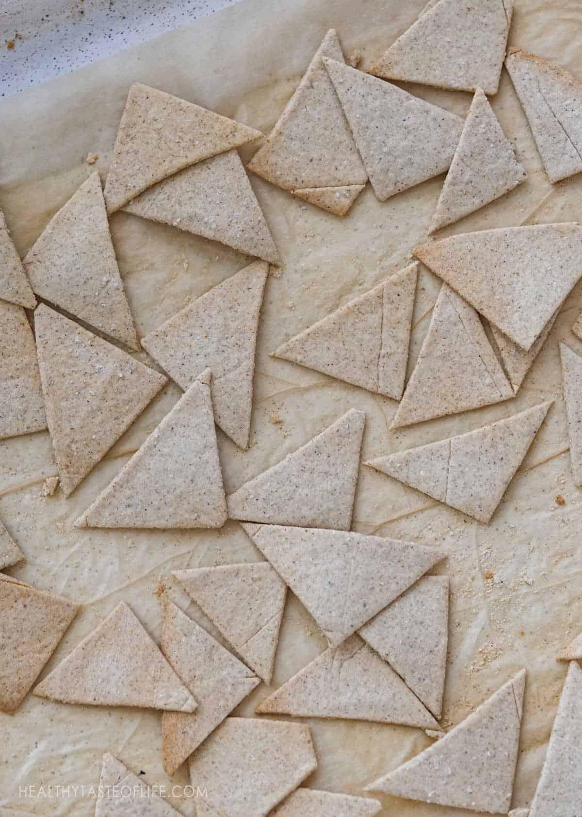 Grain free cassava crackers on a cookie sheet.