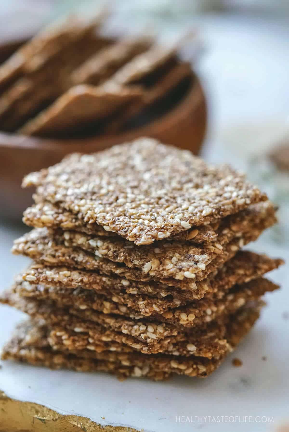 Thin crispy amaranth and seed crackers vegan gluten free snack.