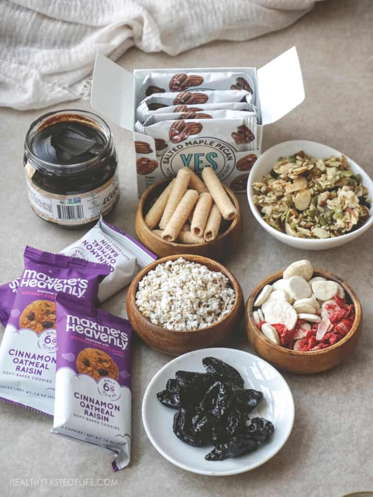 Dairy free snacks and gluten free snacks cookies dried fruit granola, crunchy rolls date and cacao spread sorghum popcorn and freeze dried fruit.
