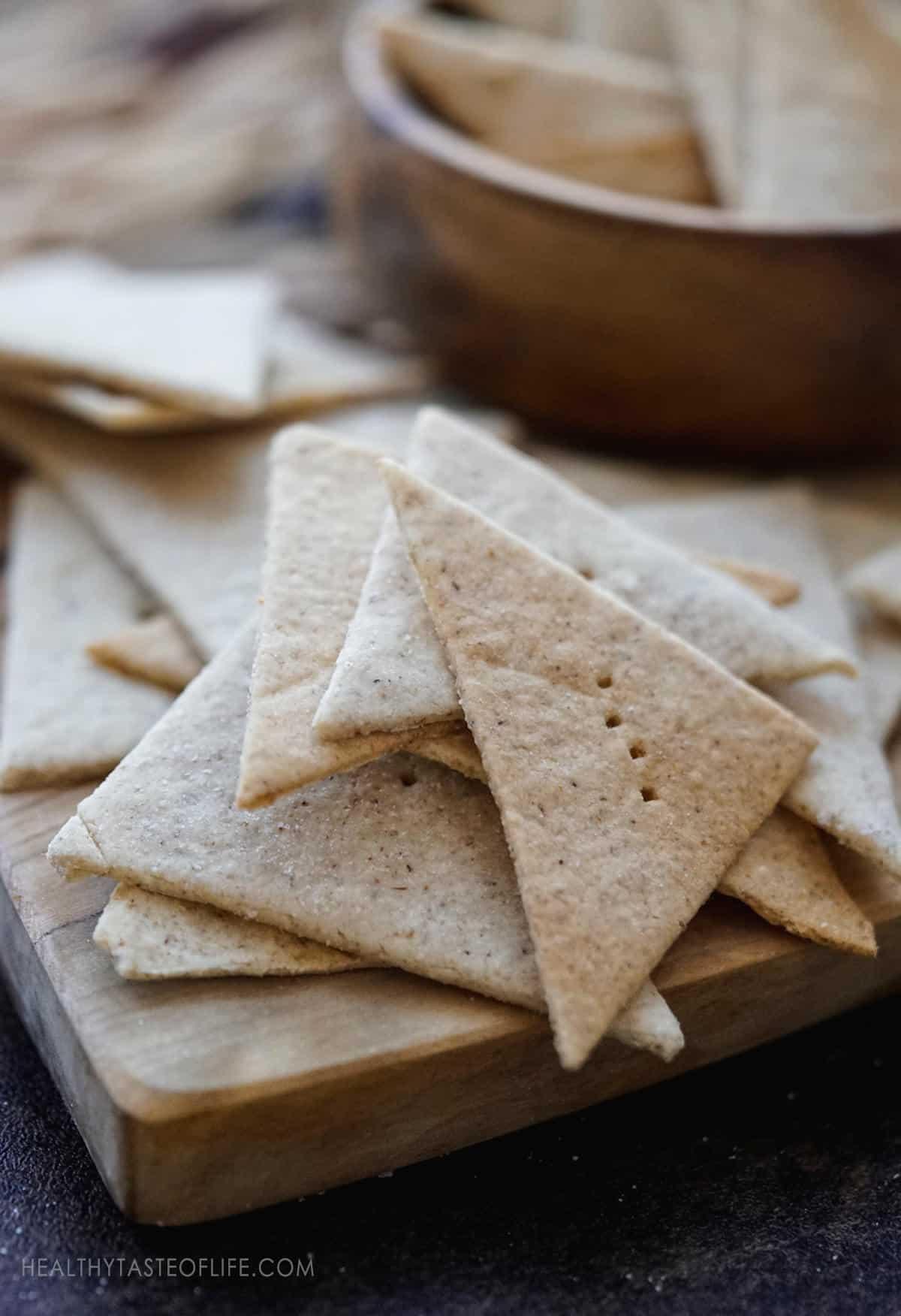 Grain free cassava crackers on a wood board.