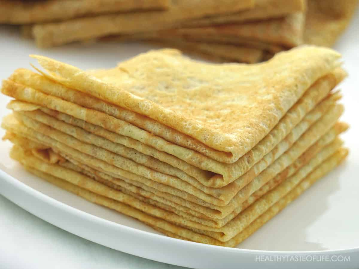 Grain free low carb crepes with almond flour and banana flour stacked on a plate.