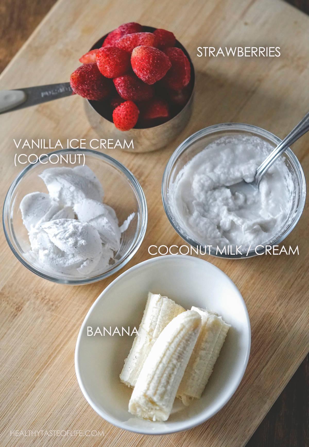 Gathered ingredients shot for a vegan strawberry banana milkshake.