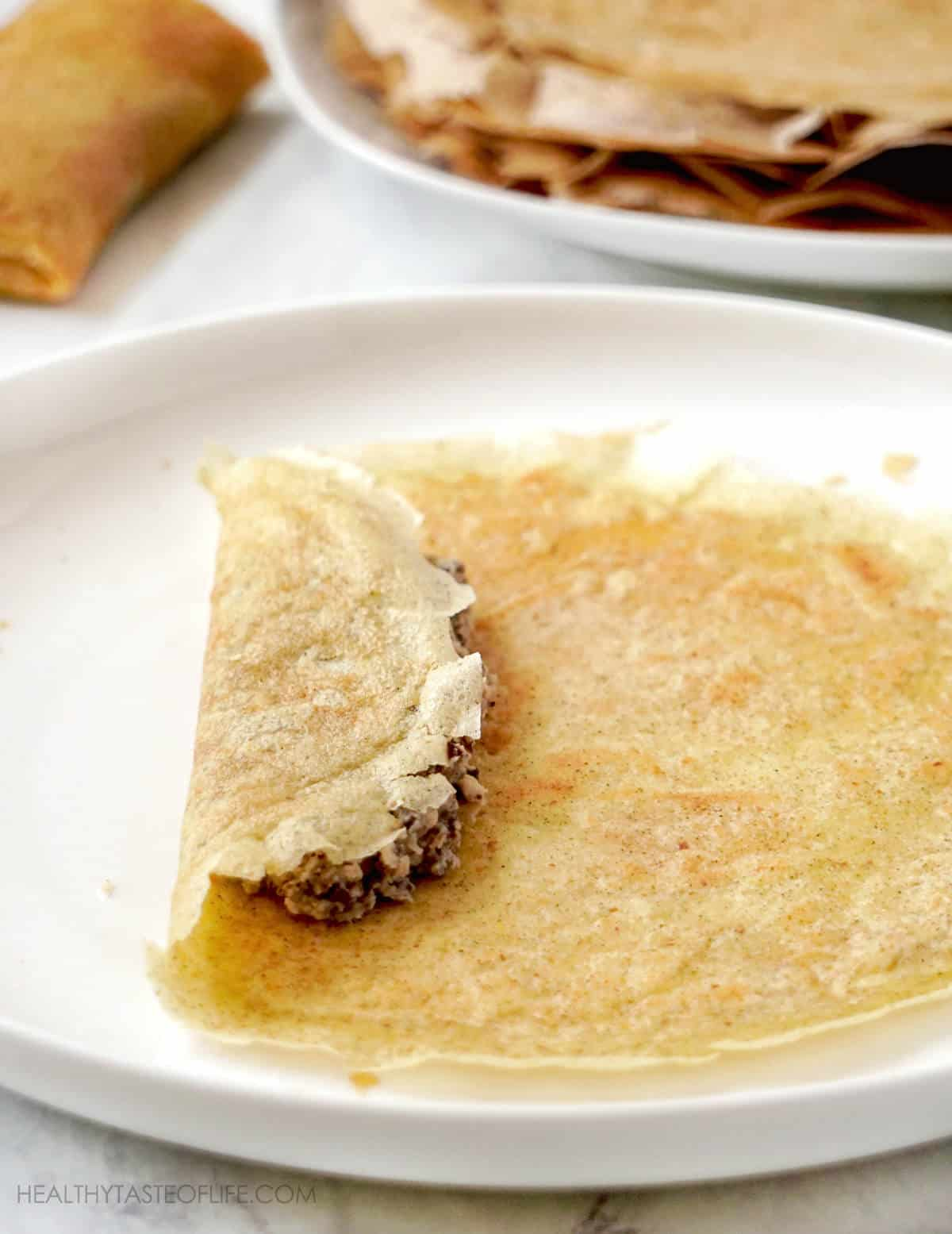 How to make grain free crepes from scratch and fill them up with meat filling.