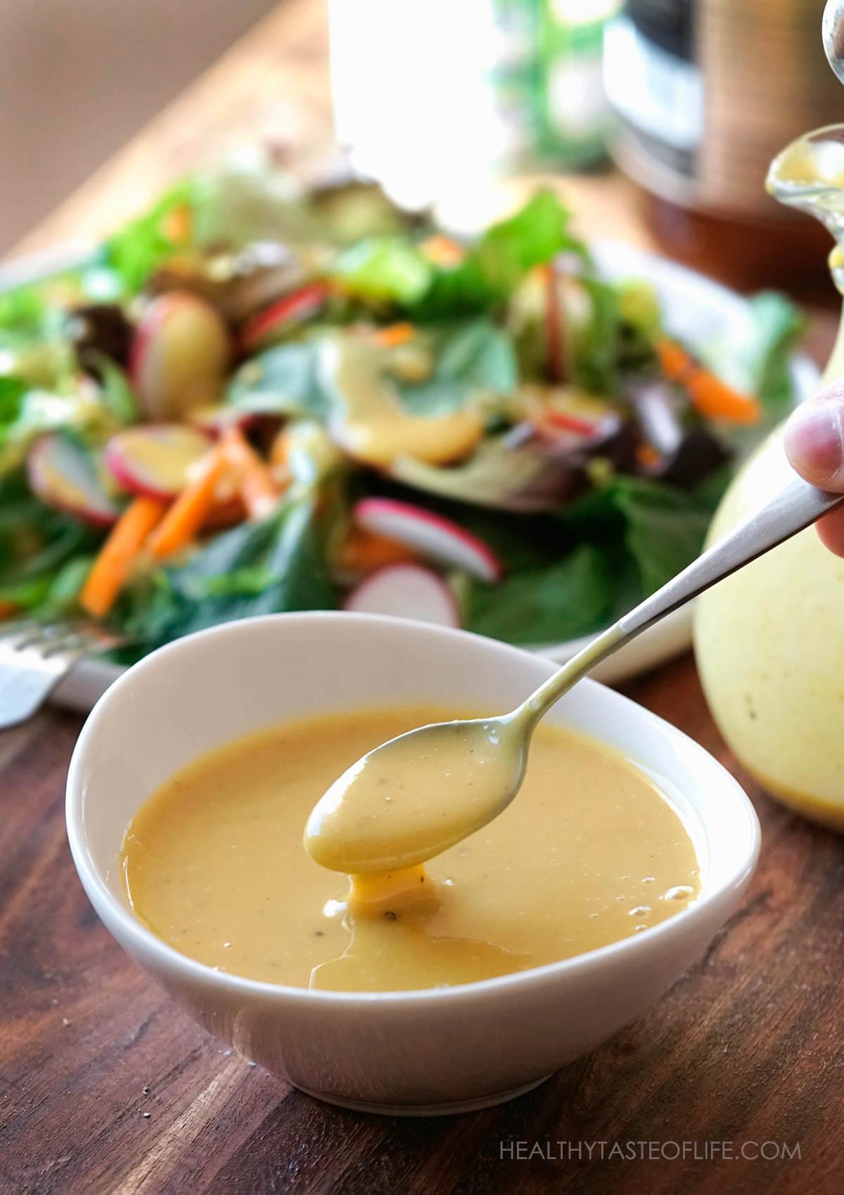 Vegan honey mustard sauce or dressing in bowl.