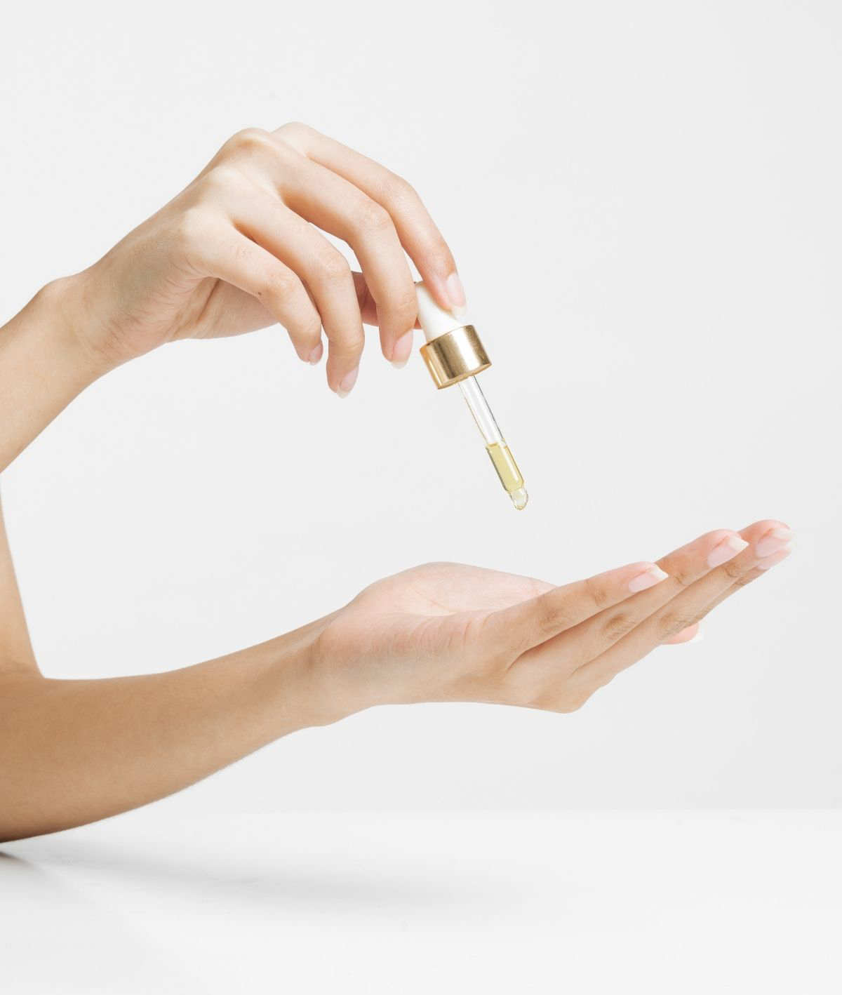 Pouring essential oil for period pain.