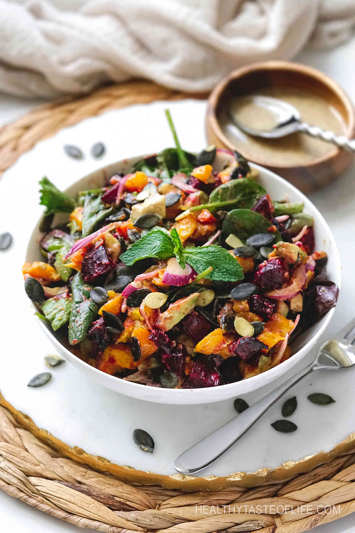 Pumpkin and beetroot salad with roasted veggies and dressing.