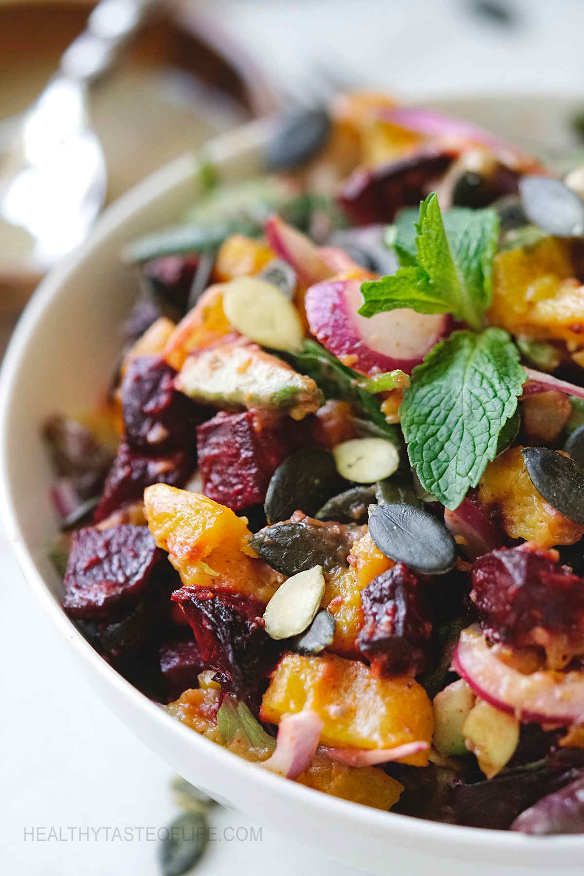 Roast pumpkin and beetroot salad with dressing.