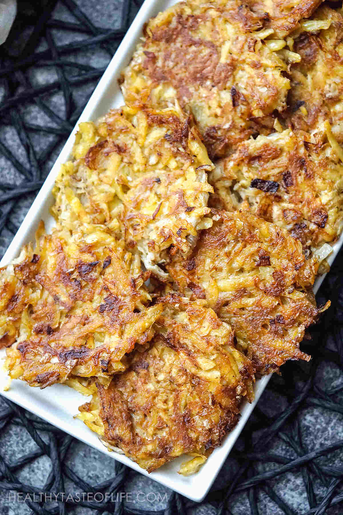 Potato fritters with crab arranged on a platter.